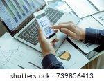 businessman checks his company...   Shutterstock . vector #739856413