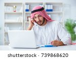 Arab businessman working in the ...