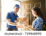 handsome hispanic delivery guy... | Shutterstock . vector #739868890