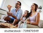 happy family sharing pizza... | Shutterstock . vector #739870549