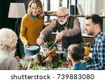 grandfather cutting turkey for... | Shutterstock . vector #739883080