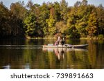 Fishing with kayak - stock photo