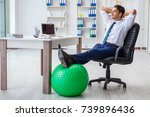 young businessman doing sports... | Shutterstock . vector #739896436