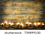 christmas lights bulb on wood... | Shutterstock . vector #739899130