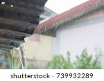 rain flows down from a roof... | Shutterstock . vector #739932289