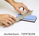 knife sharpening with whetstone ... | Shutterstock . vector #739978198
