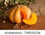 Pumpkin Lies On A Wooden Board ...