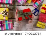 woman is packing presents  top... | Shutterstock . vector #740013784