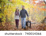 Stock photo a couple with her dog in autumn park bernese mountain dog 740014366
