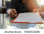 Small photo of Close up of business man signing contract making a deal, business contract details. Businessman signing an official document