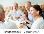 group of senior companions... | Shutterstock . vector #740048914