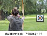 woman archer to use a bow and... | Shutterstock . vector #740069449