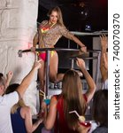 Small photo of Positive english gogo dancer woman dancing in the night club on holiday