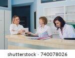 doctors having discussion... | Shutterstock . vector #740078026
