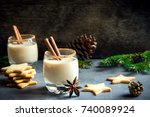 eggnog with cinnamon and nutmeg ... | Shutterstock . vector #740089924