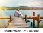 a couple on the wooden jetty at ... | Shutterstock . vector #740100100