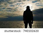 silhouette of lonely man in... | Shutterstock . vector #740102620
