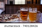 beer and pizza in a brasserie | Shutterstock . vector #740128426