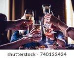 glasses of white wine seen... | Shutterstock . vector #740133424