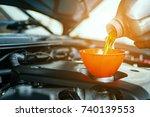 Hand mechanic in repairing car,Change the Oil - stock photo