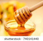 honey dripping from honey... | Shutterstock . vector #740141440