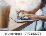 woman   s hands using laptop in ... | Shutterstock . vector #740152273