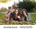 three girlfriends lying on the... | Shutterstock . vector #740153290