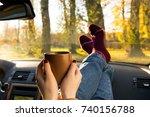 autumn car trip. woman feet in... | Shutterstock . vector #740156788