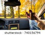 autumn car trip. woman feet in... | Shutterstock . vector #740156794