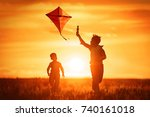Children launch a kite in the...