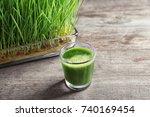 shot of wheat grass juice on...   Shutterstock . vector #740169454