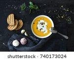 pumpkin soup with cream  seeds  ...   Shutterstock . vector #740173024