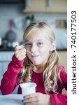 little girl eating a healthy... | Shutterstock . vector #740177503