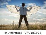boy with wings in the field in... | Shutterstock . vector #740181976
