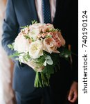 wedding bouquet in groom's hands   Shutterstock . vector #740190124