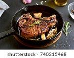 fried pork steak in frying pan  ... | Shutterstock . vector #740215468