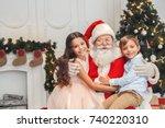 santa claus with kids indoors... | Shutterstock . vector #740220310