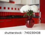 bouquet on a table of red and... | Shutterstock . vector #740230438