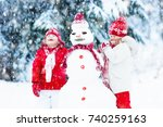 children build snowman. kids... | Shutterstock . vector #740259163