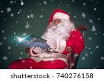 santa claus reading book in... | Shutterstock . vector #740276158