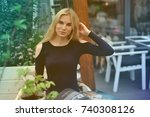 blond girl sitting in cafe and... | Shutterstock . vector #740308126
