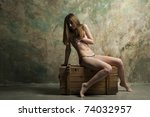 skinny woman sitting on a... | Shutterstock . vector #74032957