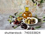 Small photo of olive products - olive oil, dried olives, pickled olives, olives stuffed with cornichons.