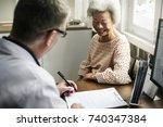 an elderly patient meeting... | Shutterstock . vector #740347384