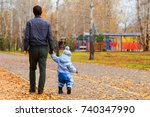 father and son walking in the... | Shutterstock . vector #740347990