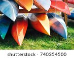 Small photo of Pile of canoe, bright beautiful colored canoes