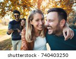 group of young people walking... | Shutterstock . vector #740403250