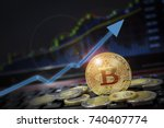 Stock photo bitcoin currency rising arrow price record highs on keyboard computer with golden bitcoin and other 740407774