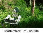 Two Adirondack Chairs Are...