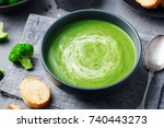 broccoli cream soup in a bowl... | Shutterstock . vector #740443273